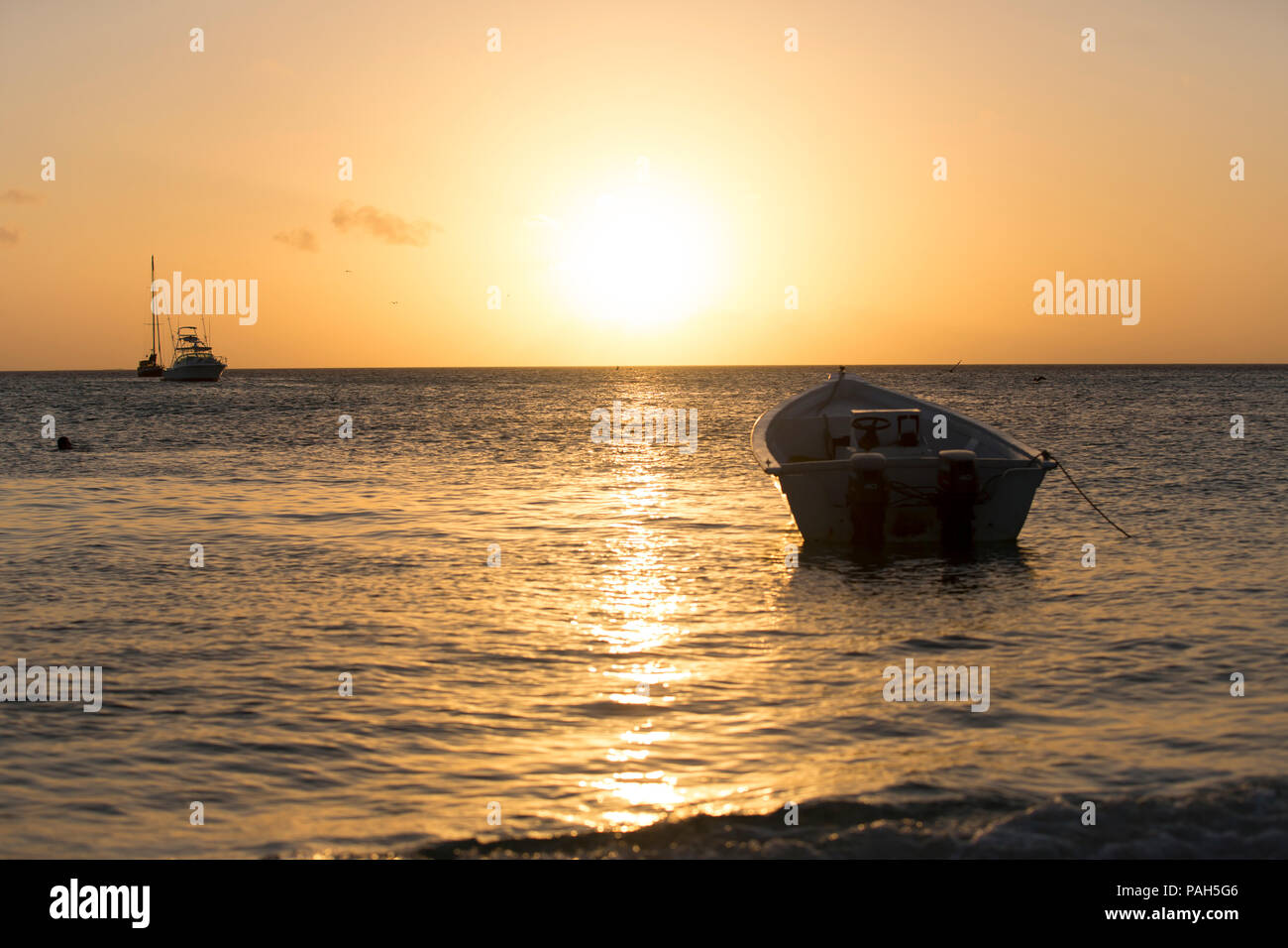 Boats in the sunset, Los Roques Islands, Venezuela - Stock Image