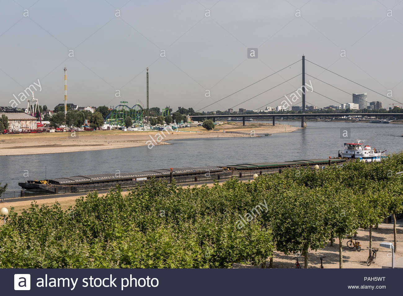 Due to persistent high temperatures and lack of precipitation, the water level of the river Rhine in Duesseldorf, Germany is lower than usual in the s Stock Photo