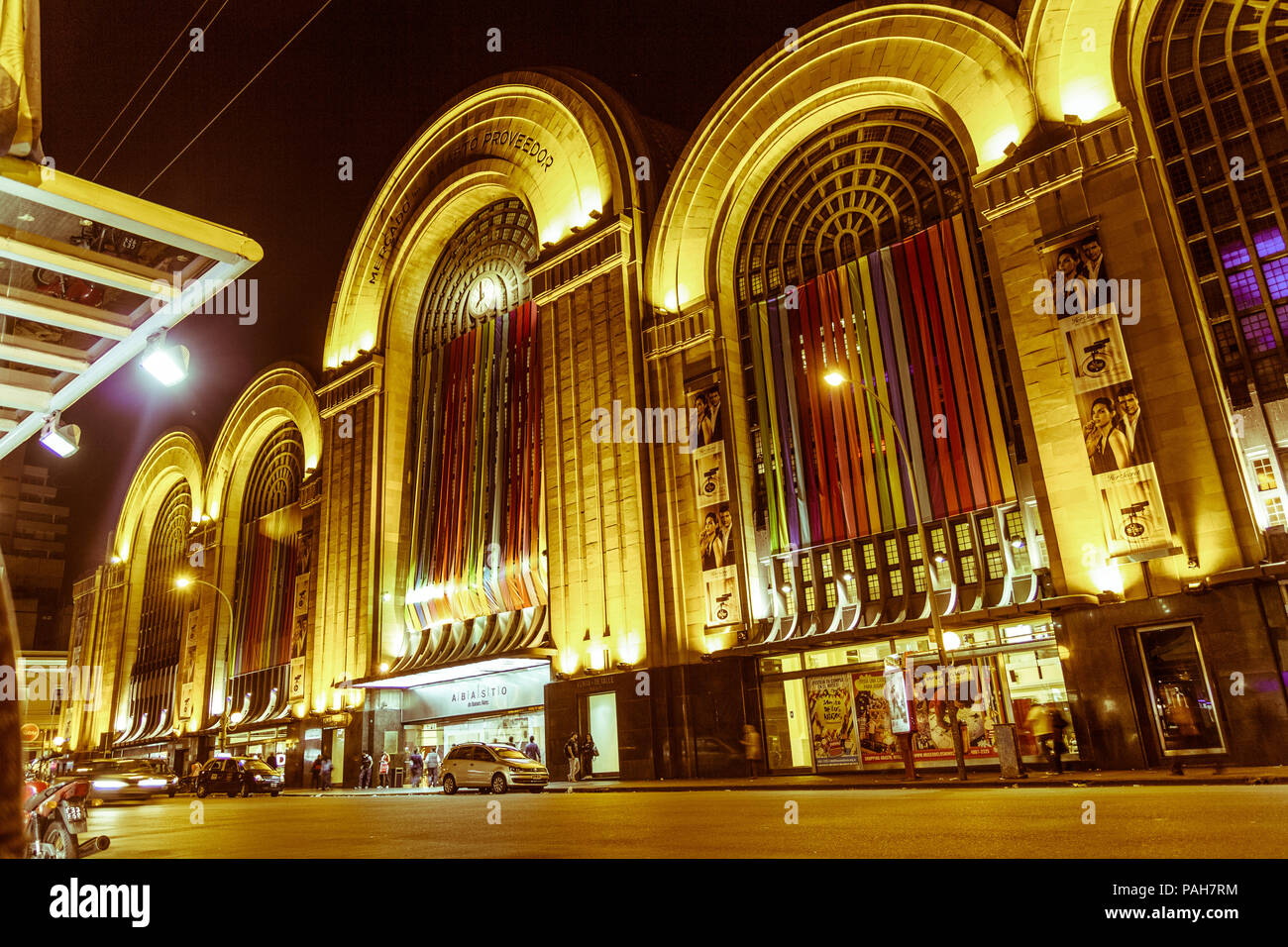 BUENOS AIRES, ARGENTINA - SEPTEMBER 20: Corrientes Street by night. Abasto building facade at Buenos Aires, Argentina.  Vintage and yesteryear effect - Stock Image