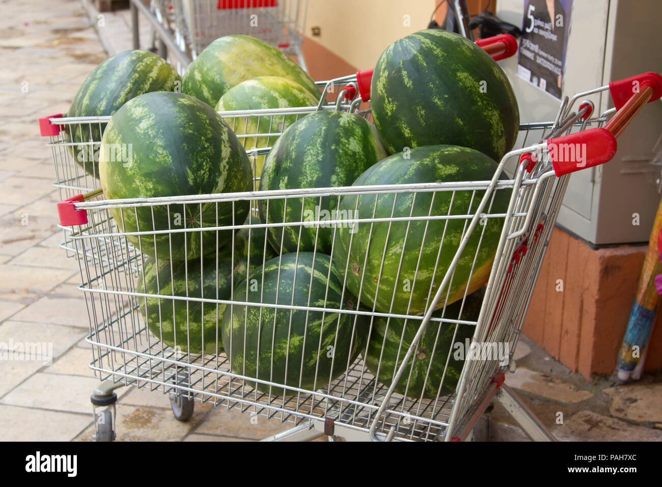 Watermelons in a supermarket trolley - Stock Image