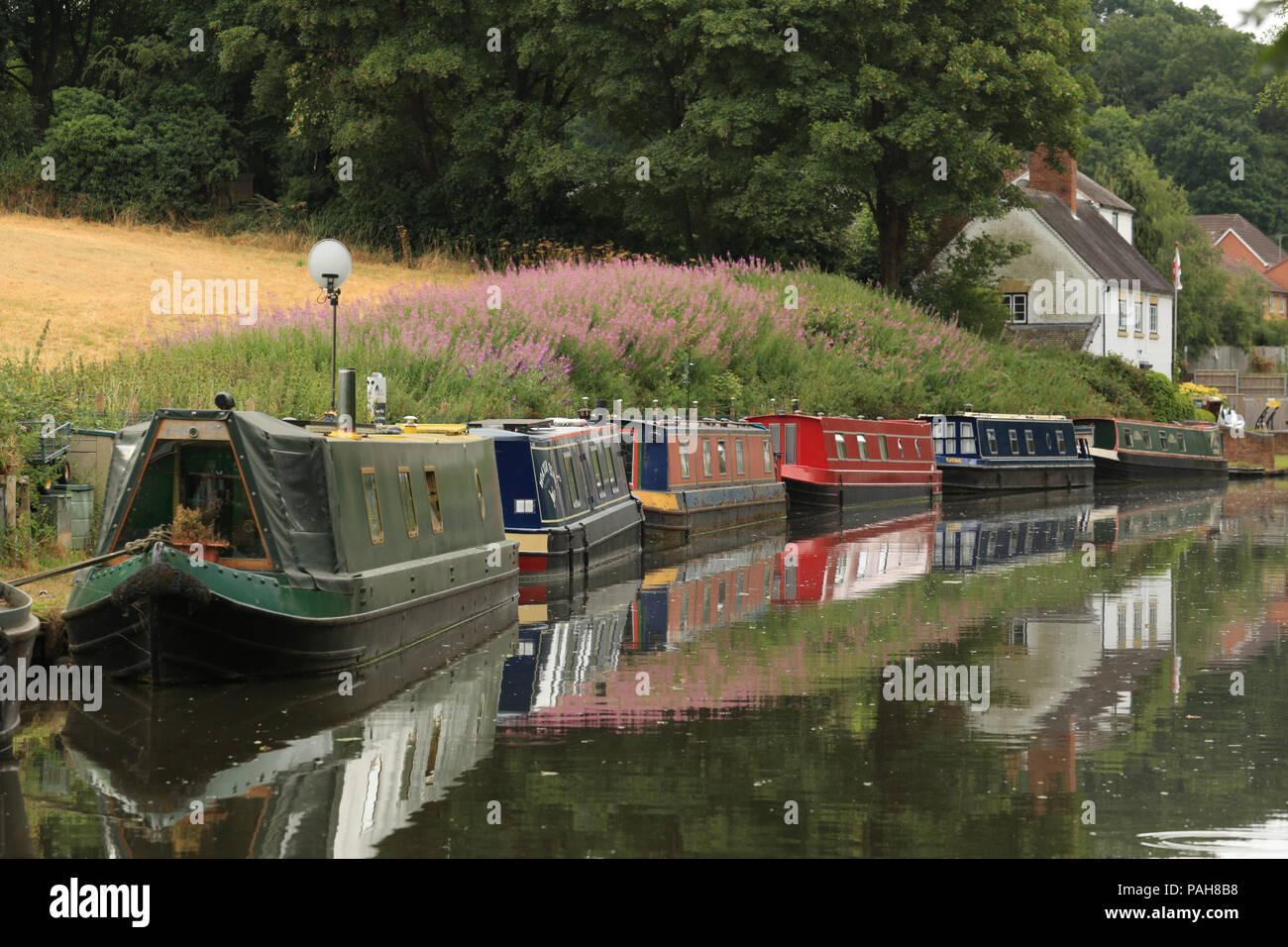 Narrowboats moored on the Staffordshire & Worcestershire canal at Stourton, near Stourbridge, West midlands, UK. - Stock Image