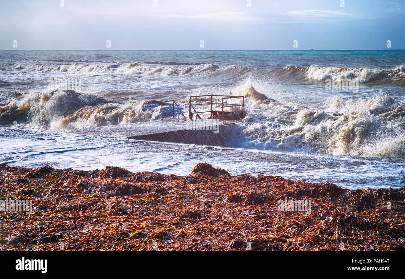 Sea storm. Waves on the sea near seacoast. Non-urban scene. - Stock Image