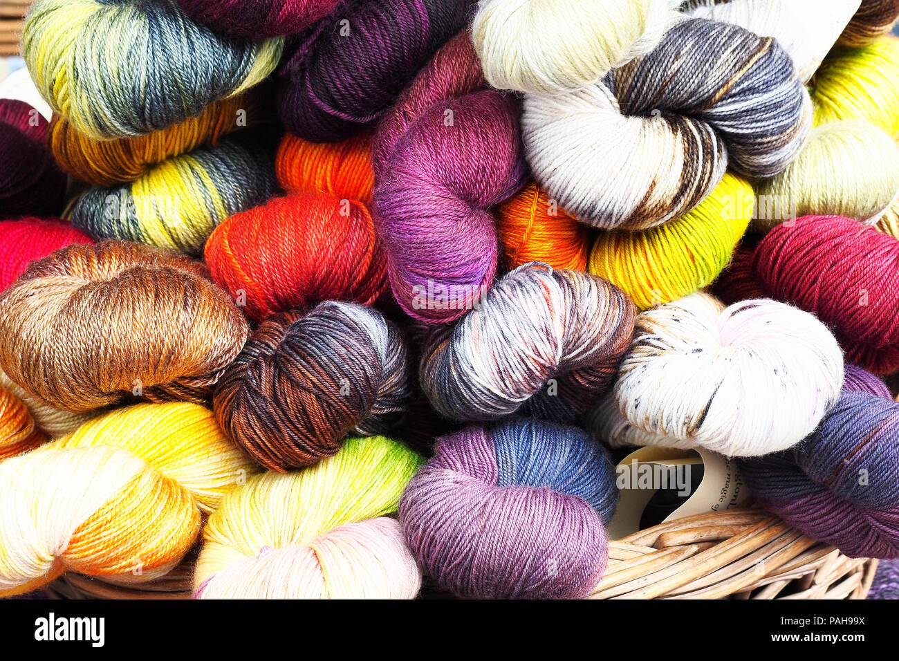 brightly coloured balls of wool Stock Photo