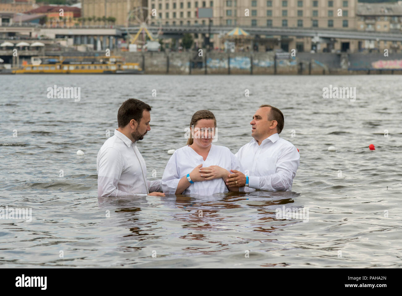 Kiev, Ukraine. July 22 2018 Two pastors baptize girl. - Stock Image