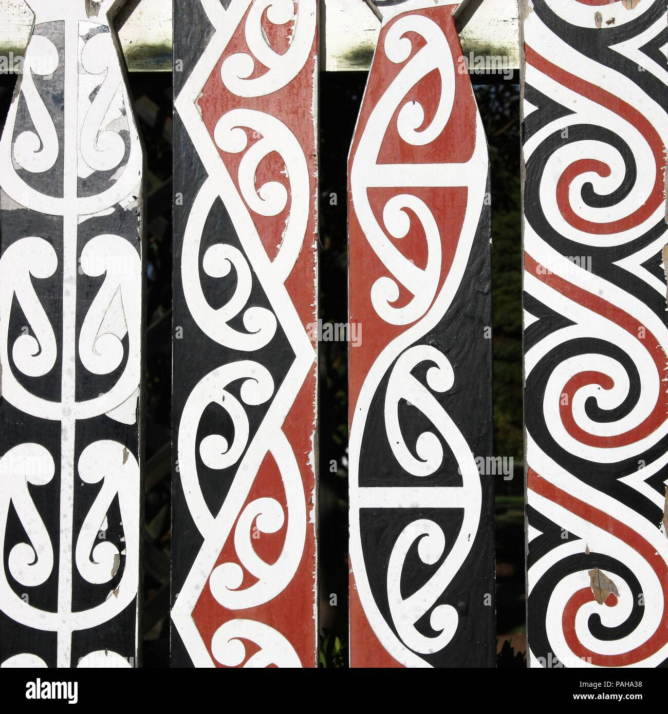 Maori painted decorations in Rotorua, New Zealand. Square composition. - Stock Image