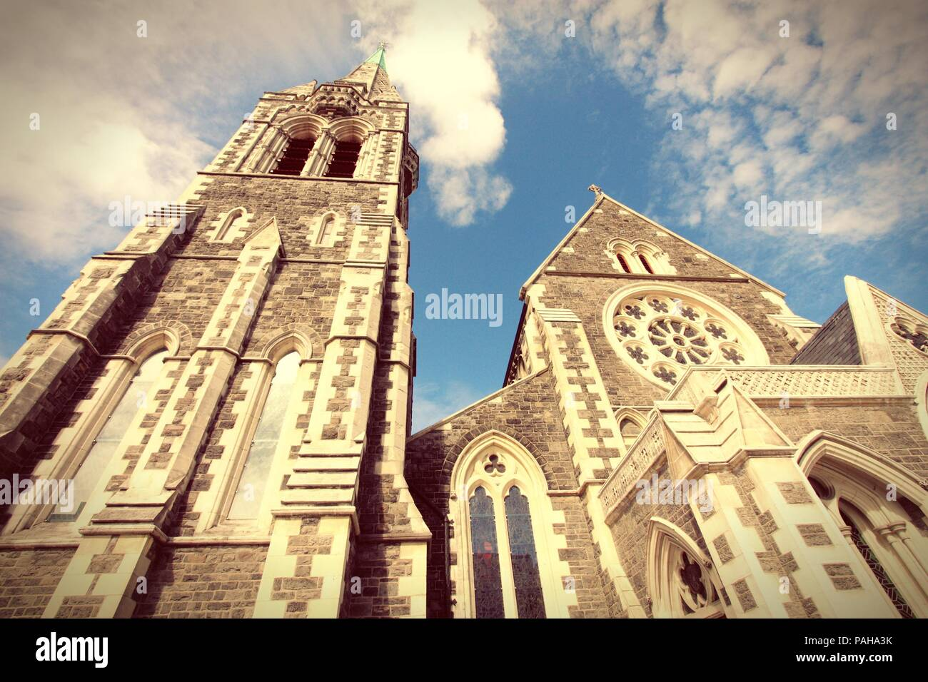 ChristChurch Anglican cathedral in Christchurch, Canterbury, New Zealand. Cross processed retro color style. - Stock Image