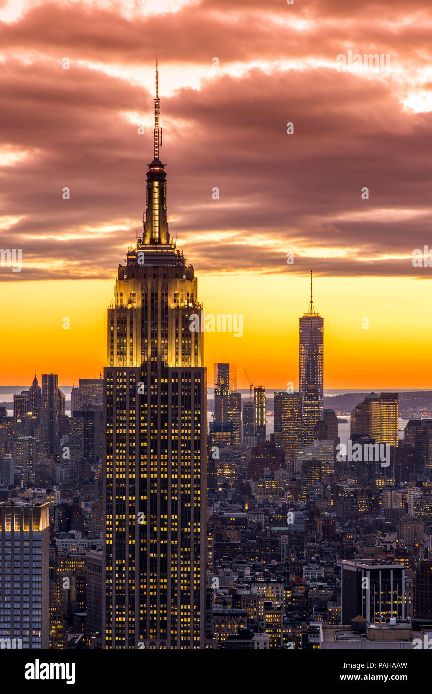 Top view at sunset of the Empire State Building with One World Trade Center in the background, Manhattan, New York, USA - Stock Image