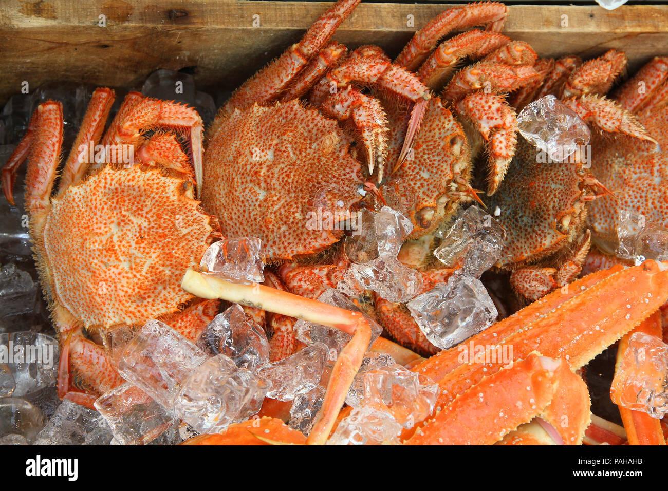 Kuromon Fish Market in Osaka, Japan. Fresh seafood - crabs in ice. - Stock Image