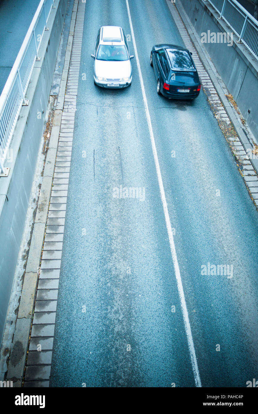 view from above of two cars on a road - Stock Image