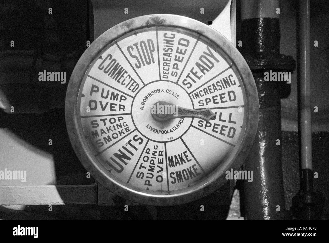 A monochrome image of an engine speed dial on the Second World War warship the HMS Belfast an iconic London landmark and a popular tourist attraction - Stock Image