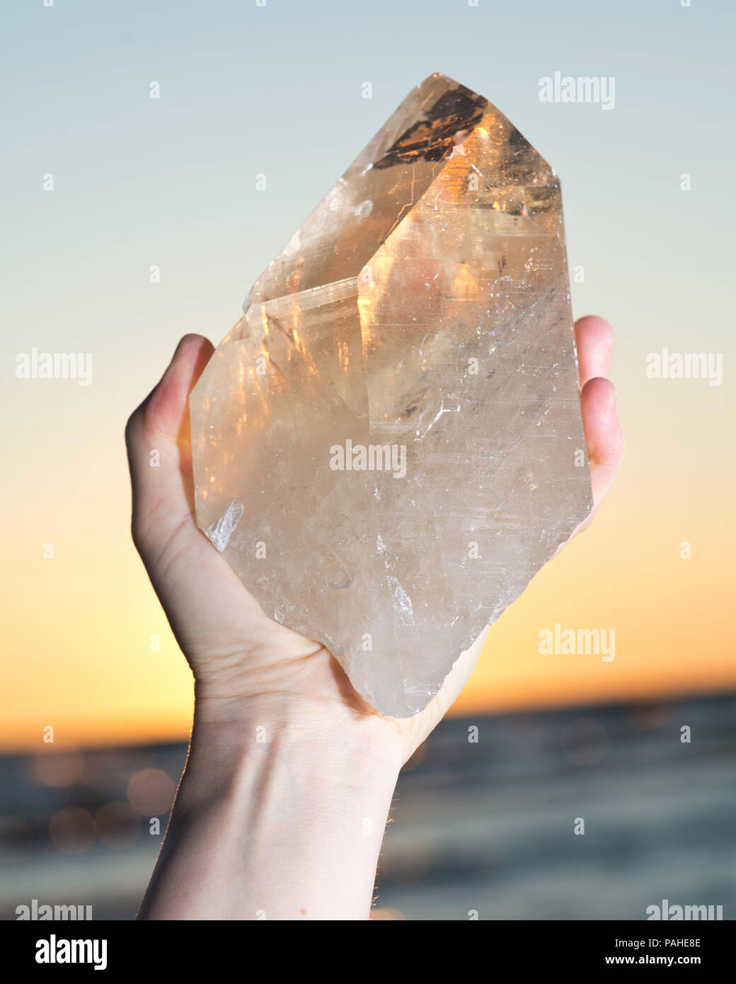 Natural Uncut Citrine Crystal Stock Photos Golden Orange 13ct Woman Holding Huge Cathedral Quartz From Brazil In Her Hand At Sunrise Front