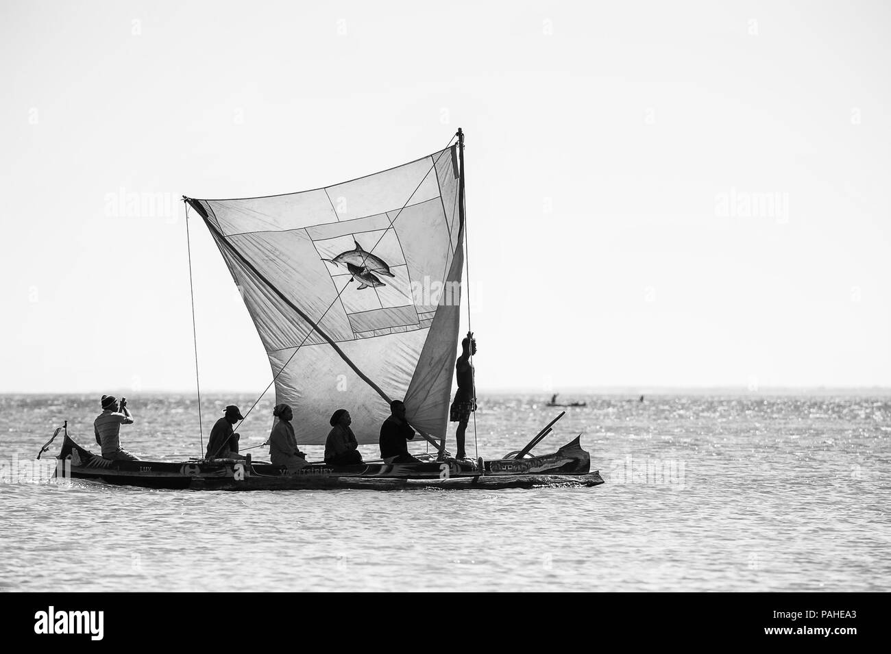 ANTANANARIVO, MADAGASCAR - JULY 3, 2011: Unidentified Madagascar people on a small boat. People in Madagascar suffer of poverty due to slow developmen - Stock Image