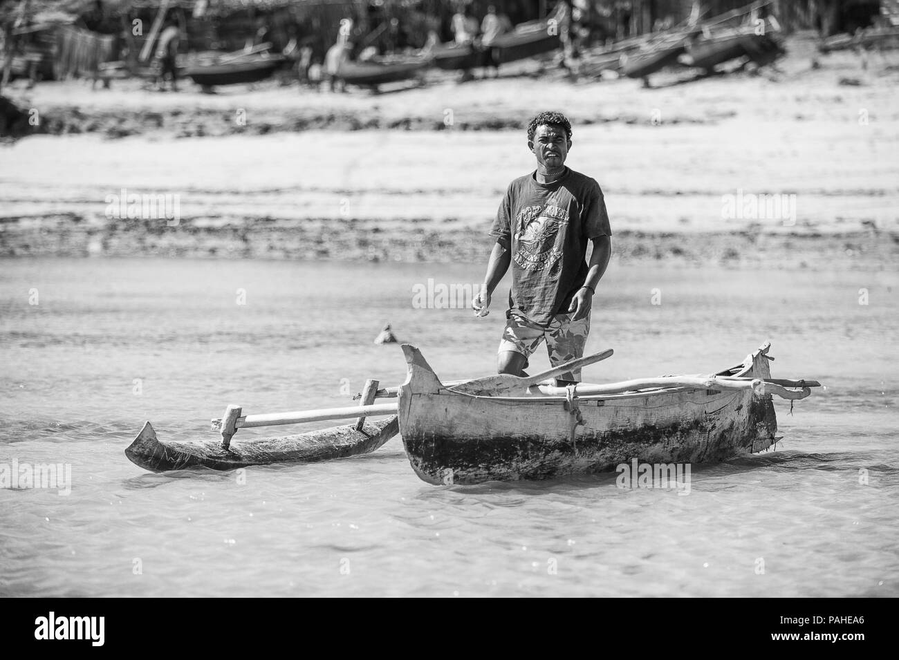 ANTANANARIVO, MADAGASCAR - JULY 3, 2011: Unidentified Madagascar man with a small boat. People in Madagascar suffer of poverty due to slow development - Stock Image