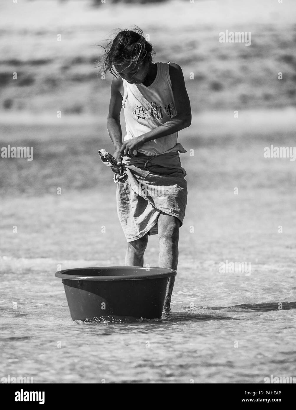 ANTANANARIVO, MADAGASCAR - JULY 3, 2011: Unidentified Madagascar beautiful girl with a basin to get water. People in Madagascar suffer of poverty due  Stock Photo