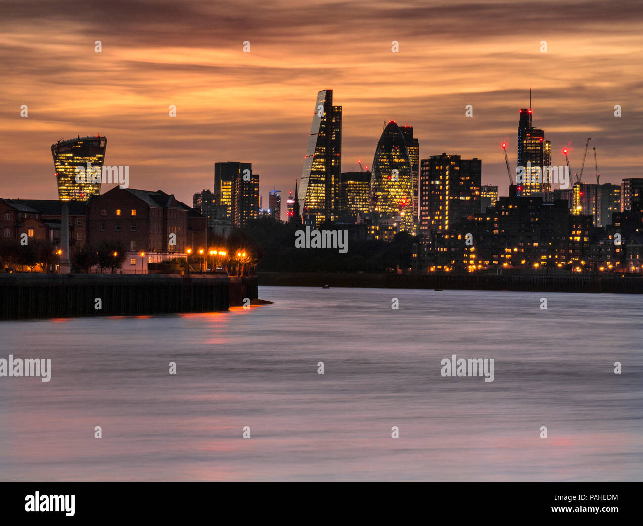 London financial city centre offices and skyscrapers towers at sunset dusk viewed along The River Thames from Canary Wharf including.... popular nickname buildings 'WalkieTalkie','Gherkin' Cheese-Grater' etc  London EC1 - Stock Image