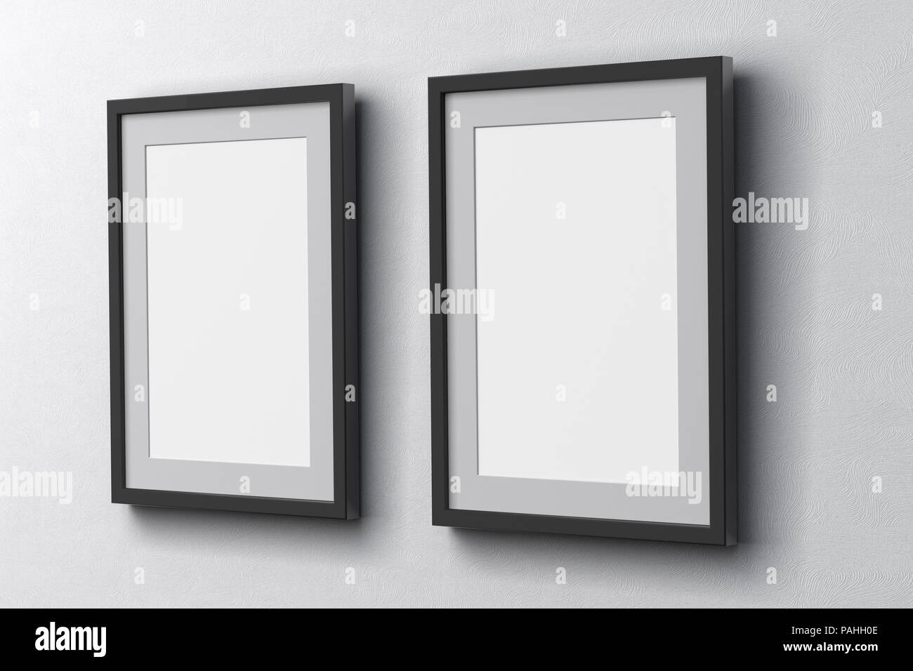 Blank two vertical posters on the white wall with dark frame and ...