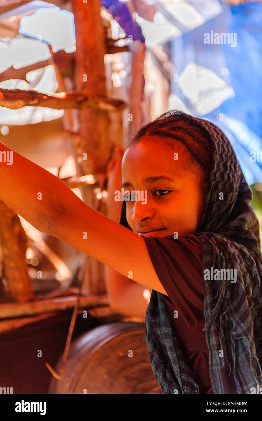 OMO, ETHIOPIA - SEPTEMBER 19, 2011: Unidentified Ethiopian little gir works at the sewing shop. People in Ethiopia suffer of poverty due to the unstab - Stock Image