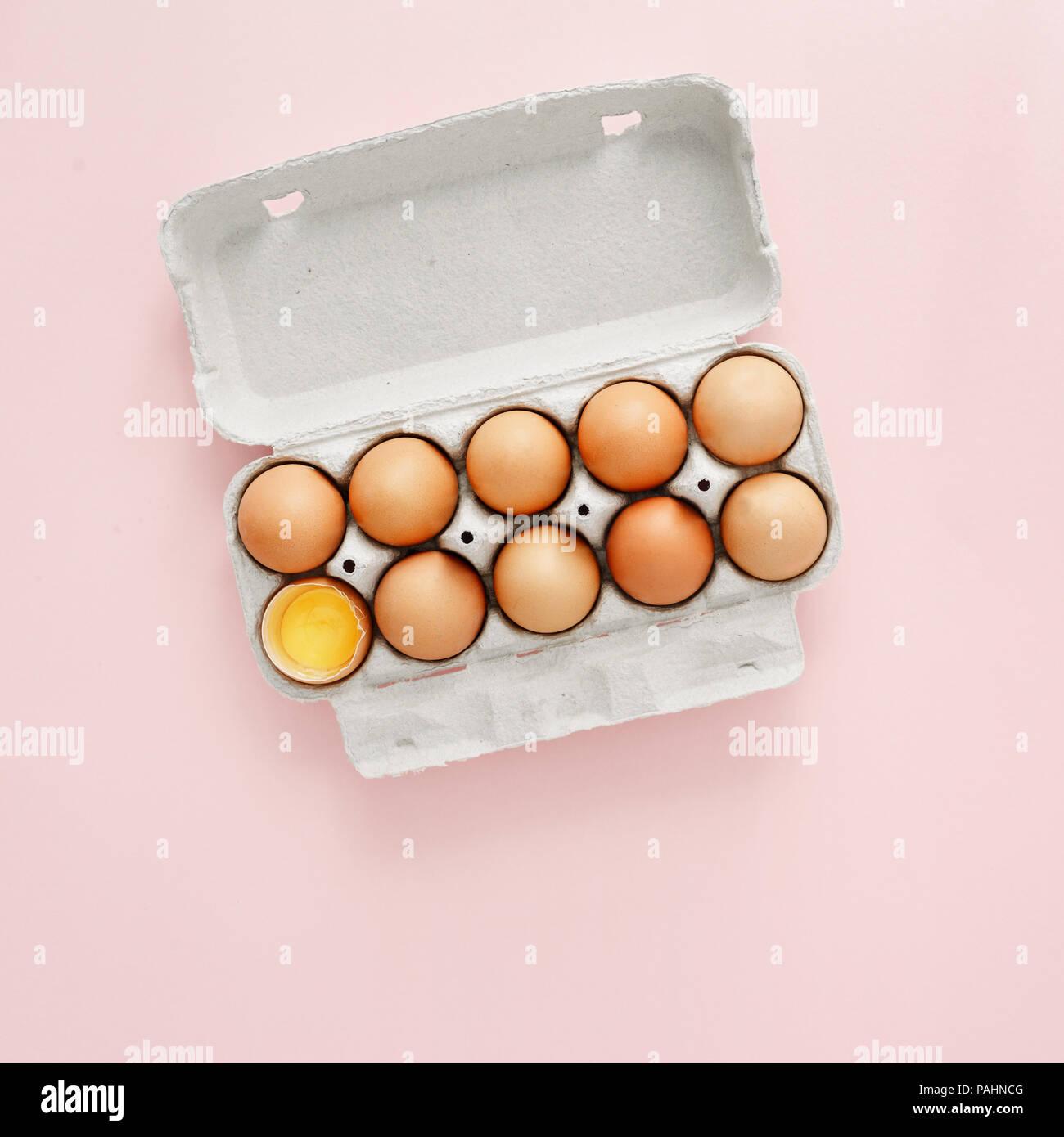 Chicken egg is half broken among other