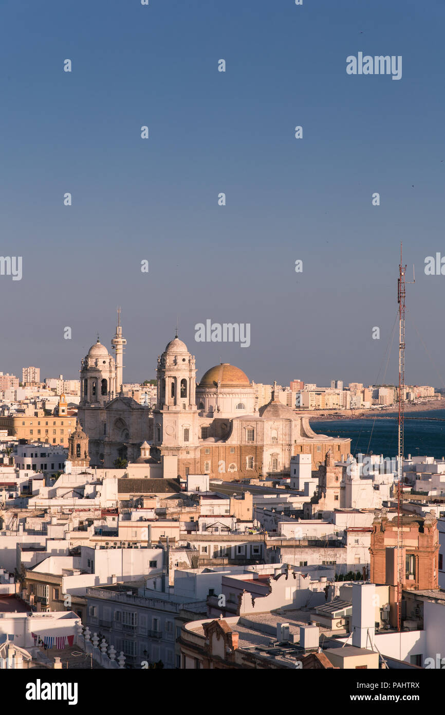 Aerial panoramic view of the old city rooftops and Cathedral de Santa Cruz in the afternoon from tower Tavira in Cadiz, Andalusia - Stock Image