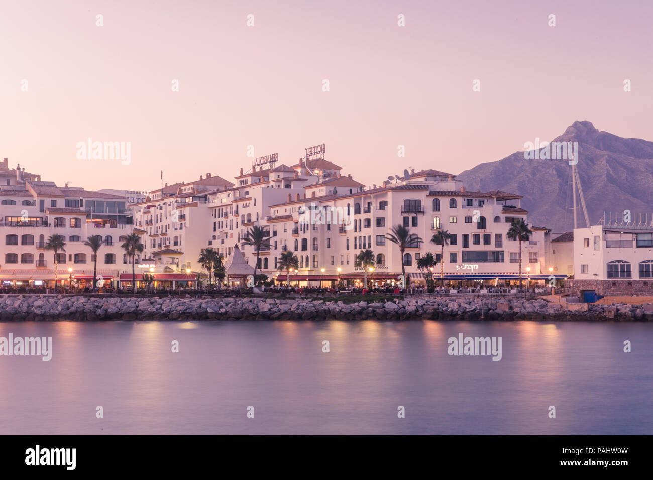 The Yacht Harbour of Puerto Banus, Andalucia, Spain on a hot summer evening. - Stock Image