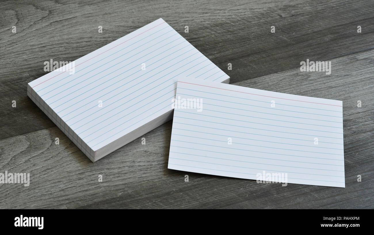 Blank Flash Index Note Cards on Dark Grey Wood Background - Stock Image