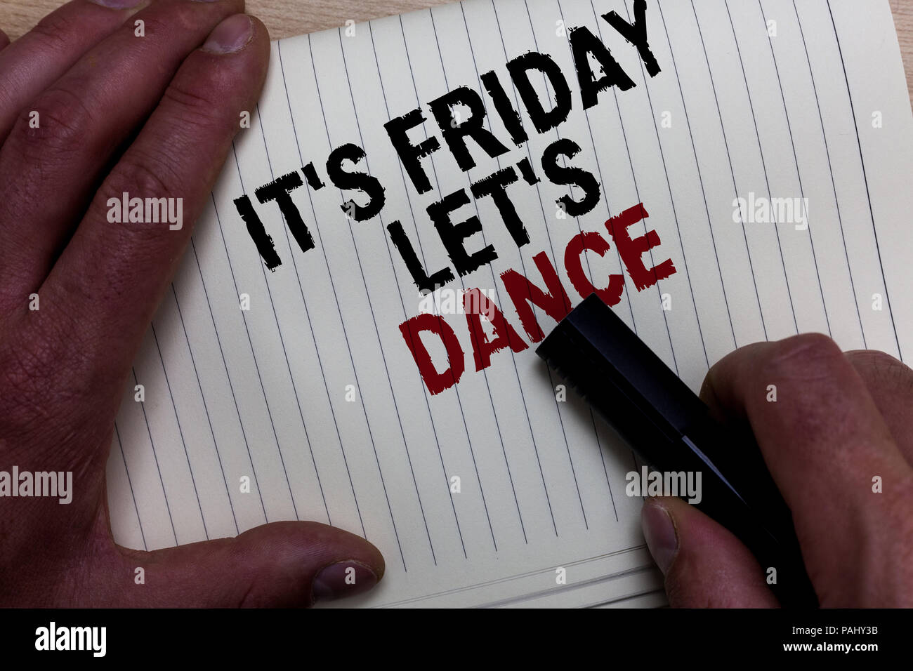 Word writing text It s is Friday Let s is Dance. Business concept for Celebrate starting the weekend Go party Disco Music Man's hand grasp black marke - Stock Image