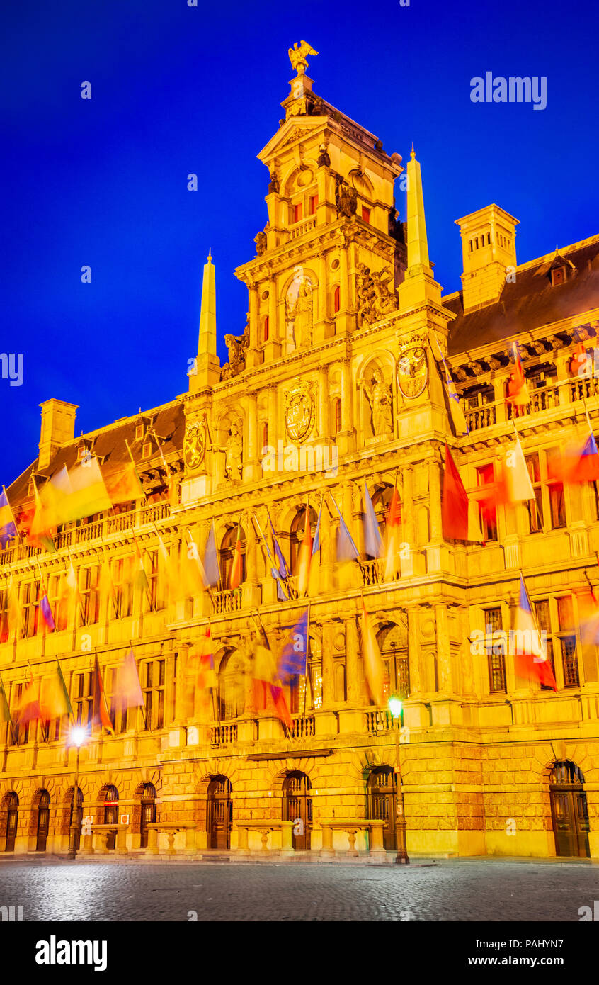 Antwerp, Belgium, Grote Markt,  spectacular central square and elegant 16th-century Stadhuis (town hall) decorated with flags - Stock Image