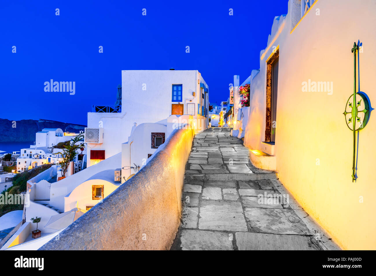 Santorini, Greece. Twilight amazing view of Oia, whitewashed city from Thira, Greek Islands. Europe holiday destination. Stock Photo