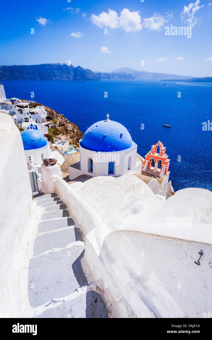 Oia, Santorini, Greece. White village with cobbled narrow paths, famous attraction of Greek Islands, Thira. - Stock Image