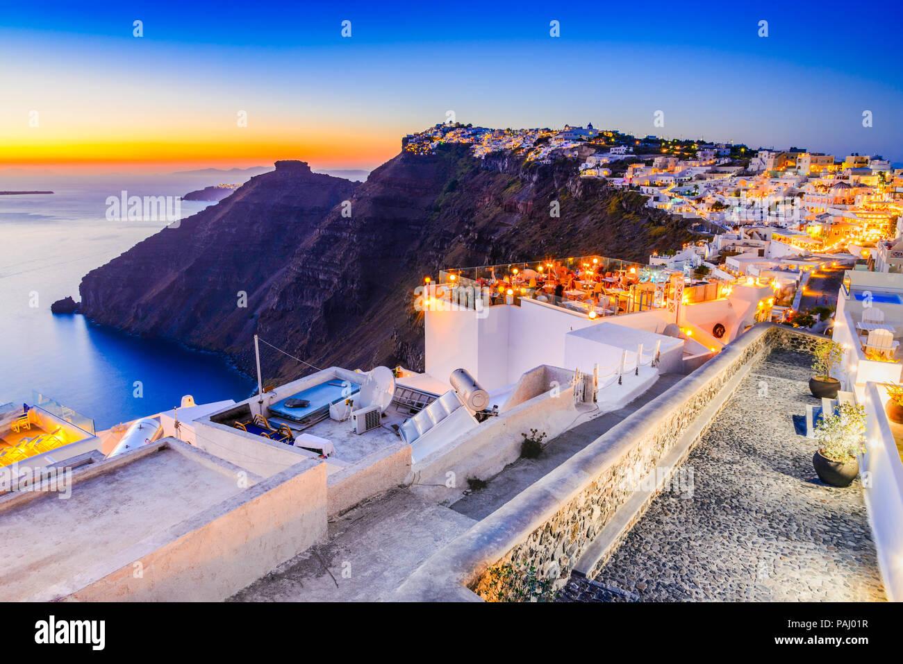 Santorini, Greece. Firostefani twilight, old village in Thira island, Cyclades at Aegean Sea. - Stock Image