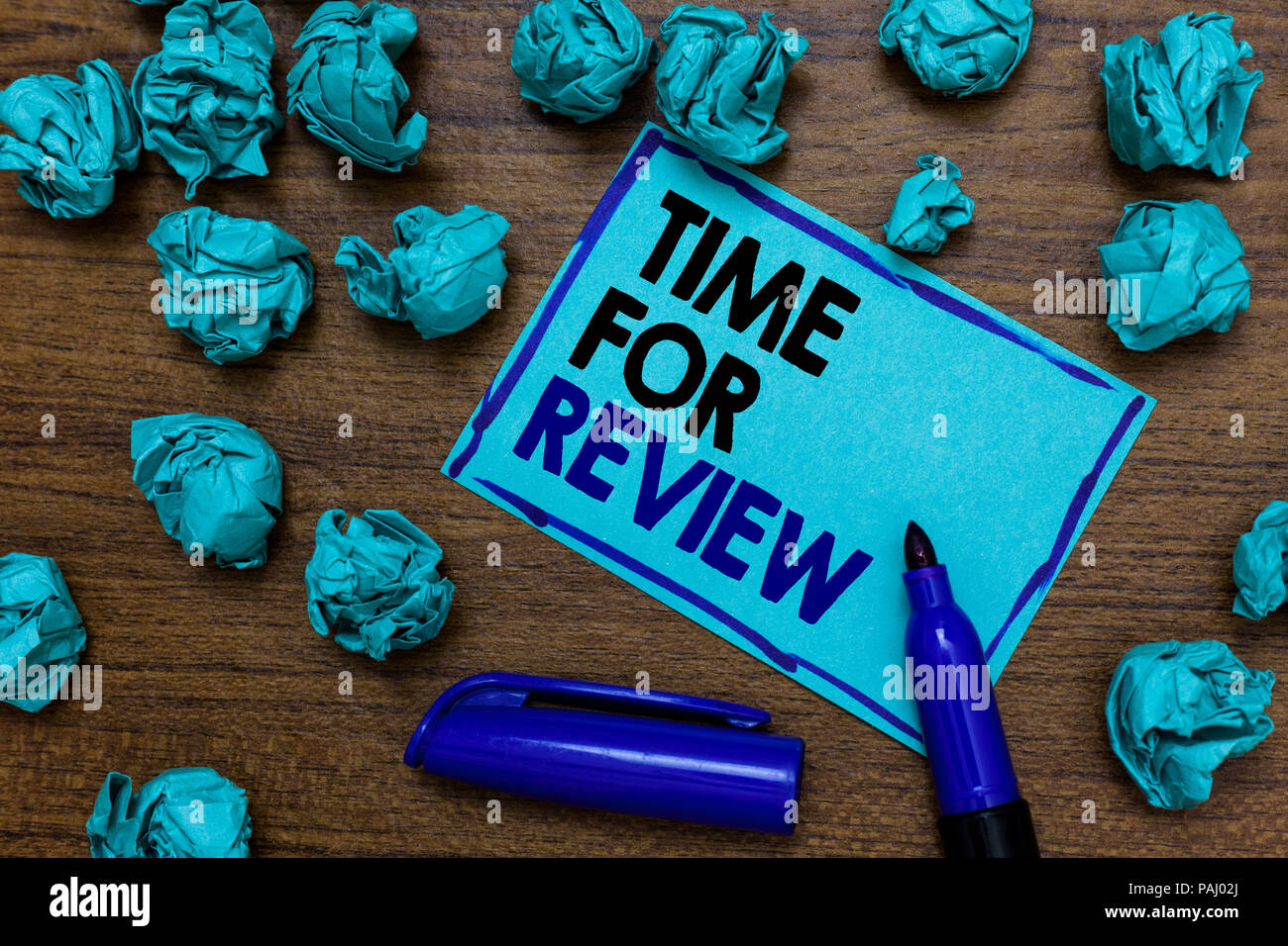Conceptual hand writing showing Time For Review. Business photo showcasing Evaluation Feedback Moment Performance Rate Assess written blue letters on  - Stock Image