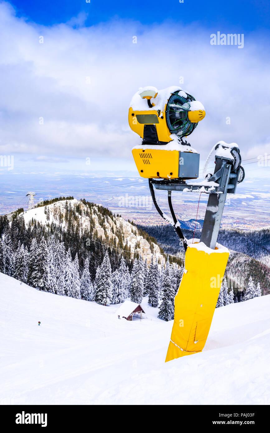 Poiana Brasov, Romania - Snow cannon on ski slopes resort in Carpathian Mountains. - Stock Image