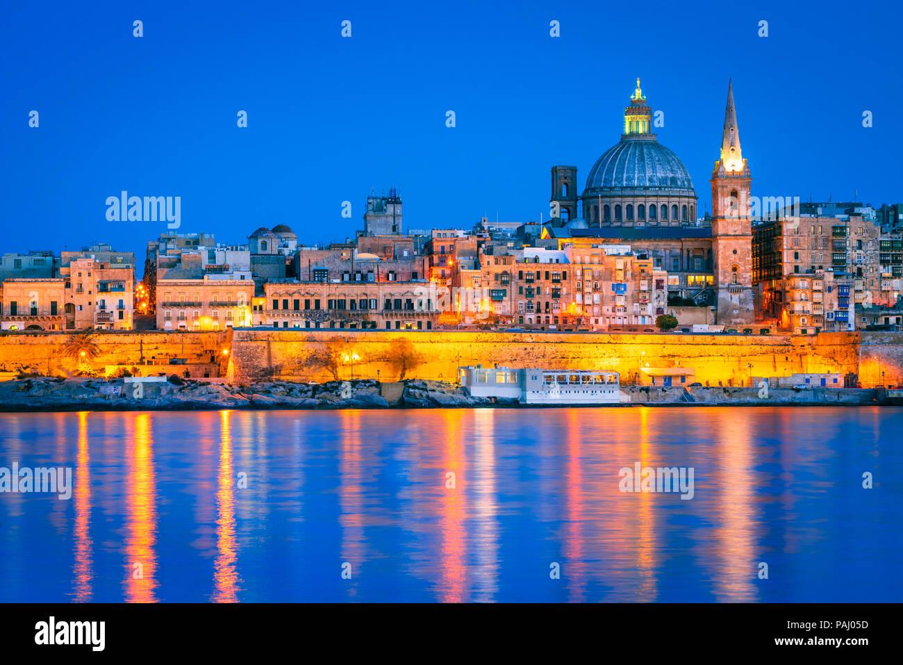 Valletta, Malta, skyline from Marsans Harbour at twilight. - Stock Image