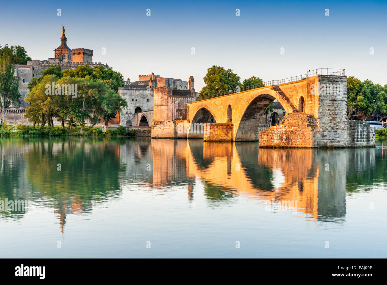 Avignon Bridge with Popes Palace and Rhone River at sunrise, Pont Saint-Benezet, Provence, France. - Stock Image