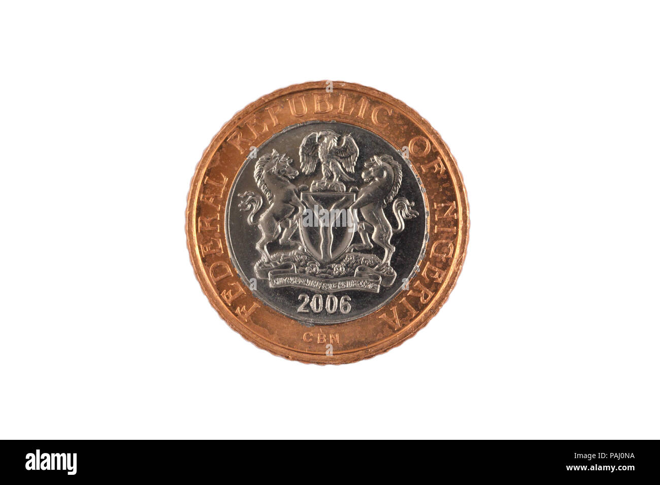 A close up image of a Nigerian two Naira bimettalic coin isolated on a white background - Stock Image