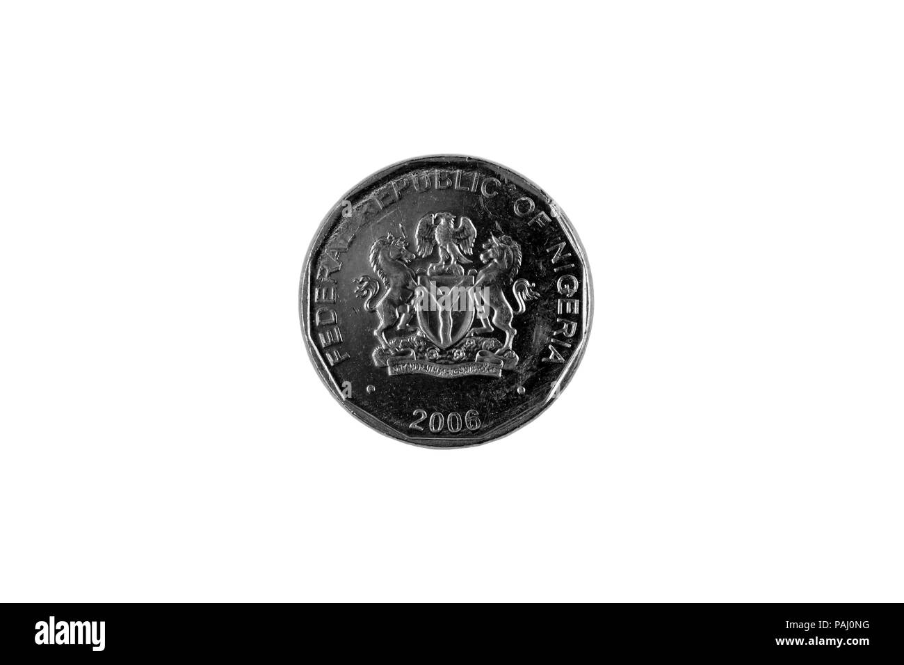 A close up image of a Nigerian 50 Kobo coin isolated on a white background - Stock Image