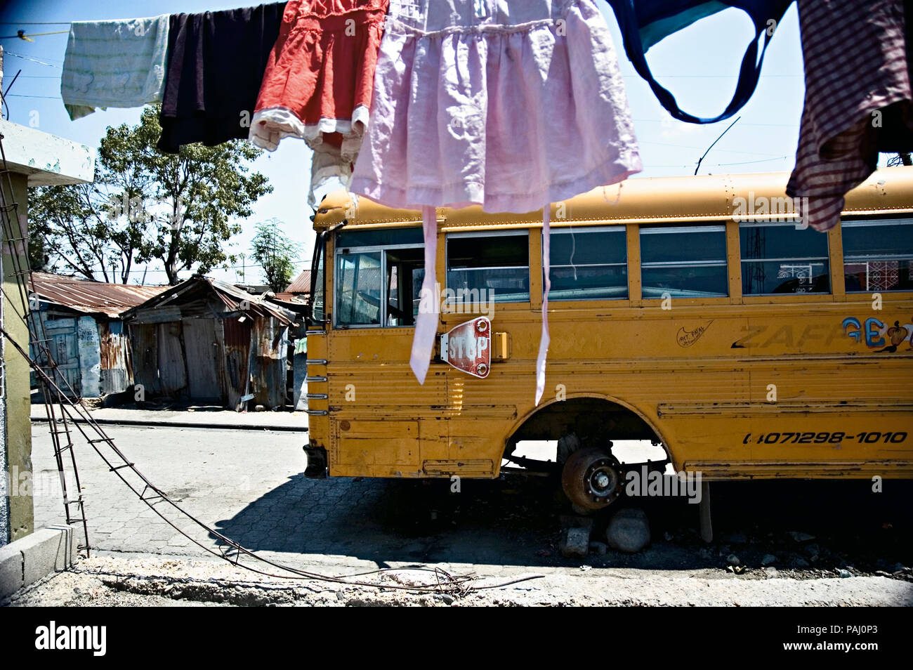 outside kasilia s home in cite soleil another home is created from a rh alamy com
