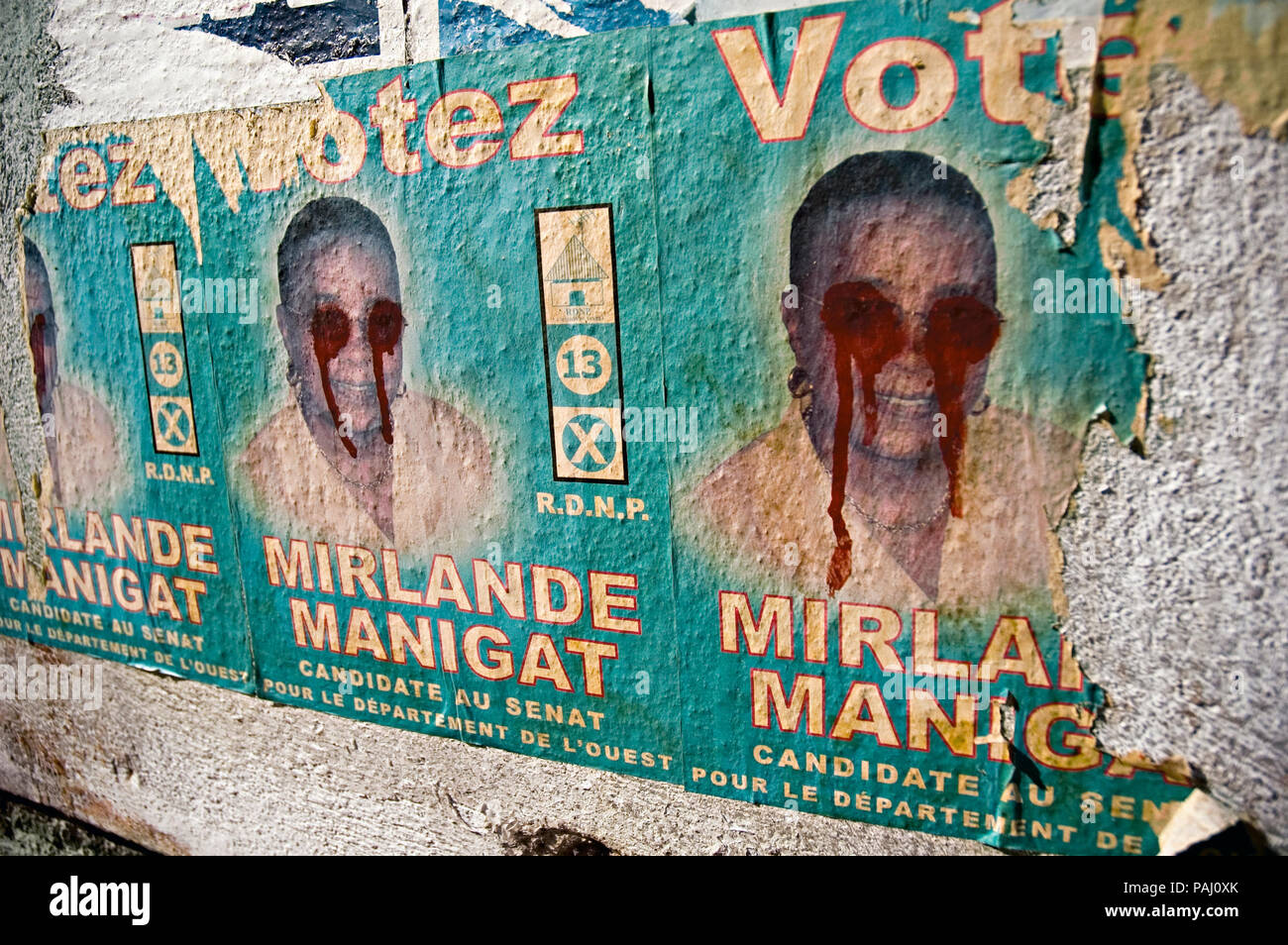 Defaced Political propaganda.  22 February 2006 - Mirlande Manigat, a RDNP candidate for the Senate in the West Department, withdrew from the election when her husband Leslie Manigat lost the presidency to Renee Preval. Stock Photo