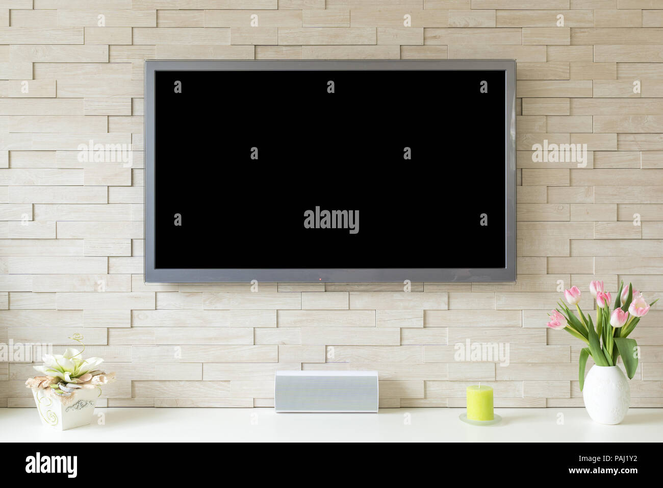 Blank Modern Flat Screen Tv At The White Brick Wall With Copy Space Stock Photo Alamy