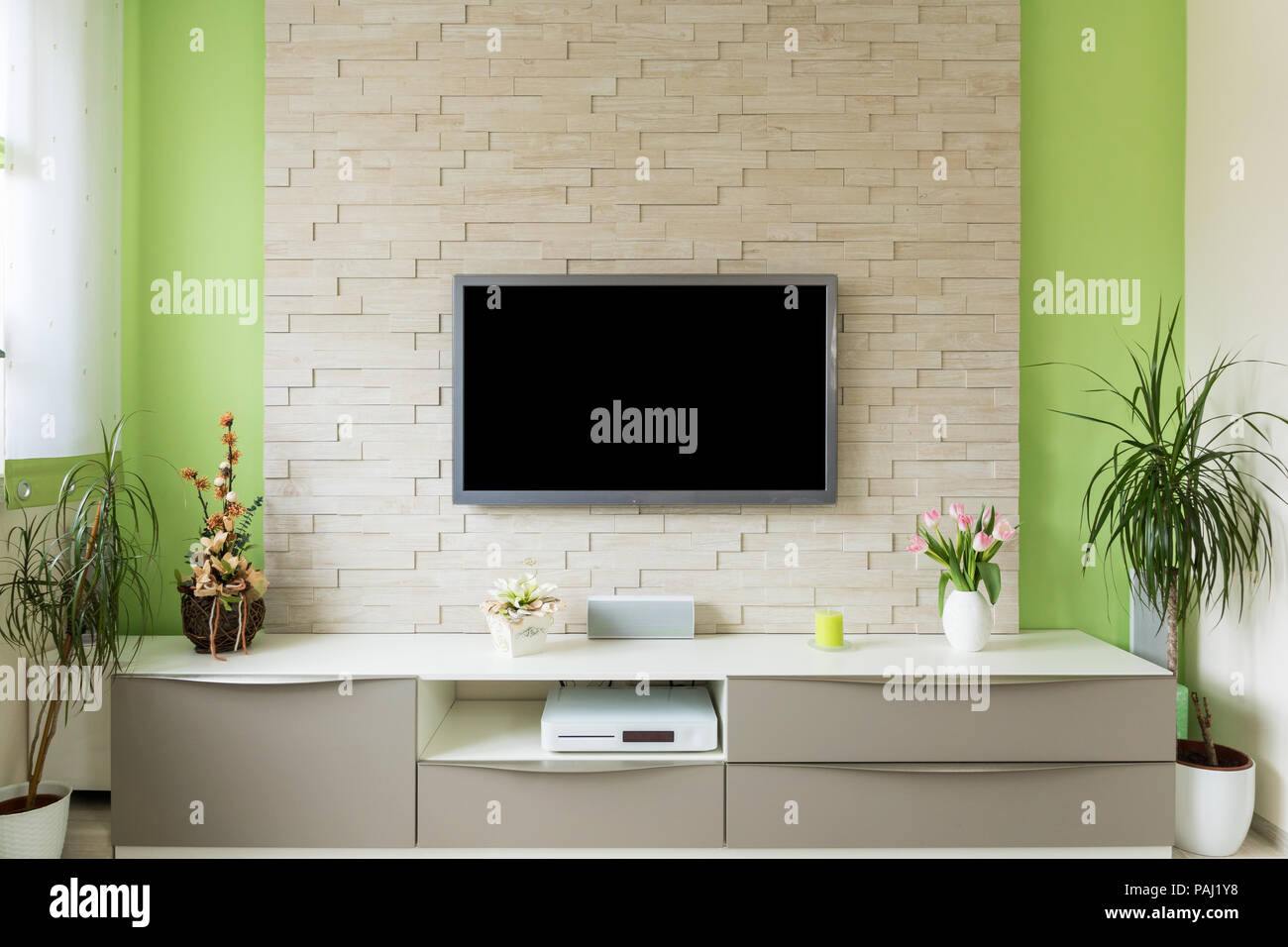Modern living room interior   tv mounted on brick wall with black ...