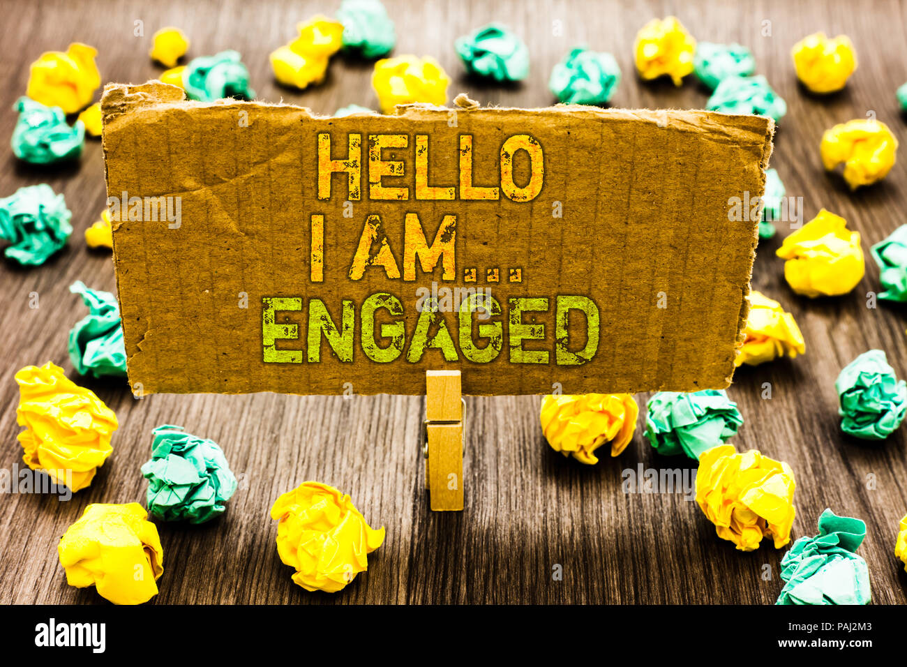 Text sign showing Hello I Am... Engaged. Conceptual photo He gave the ring We are going to get married Wedding Paperclip grip cardboard with texts man - Stock Image