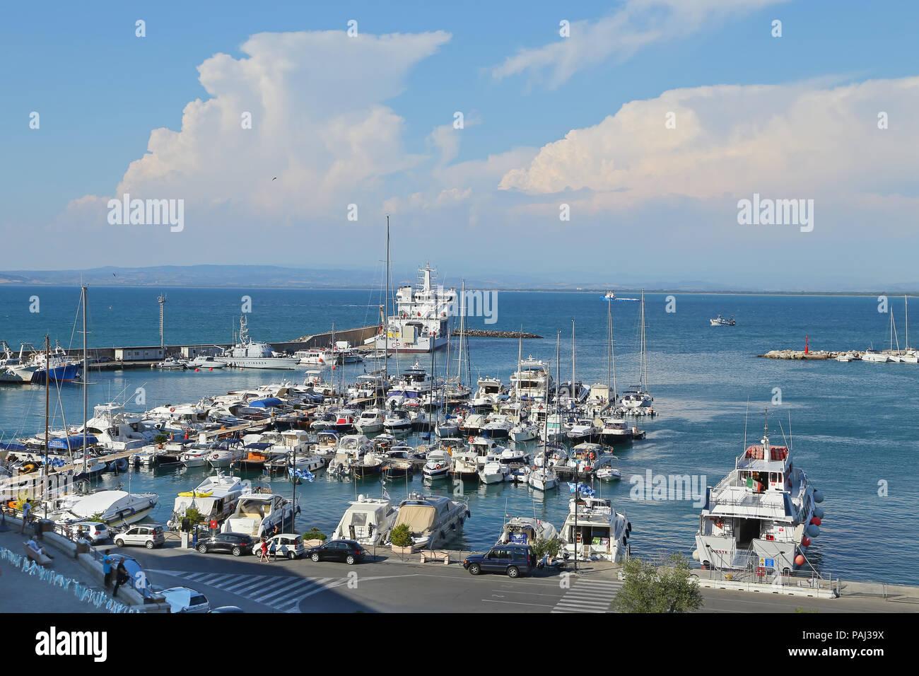 GIGLIO ISLAND, ITALY - JULY 18, 2014:Boats in the small harbor of 'Porto Santo Stefano', the pearl of the Mediterranean Sea, Tuscany - Italy - Stock Image
