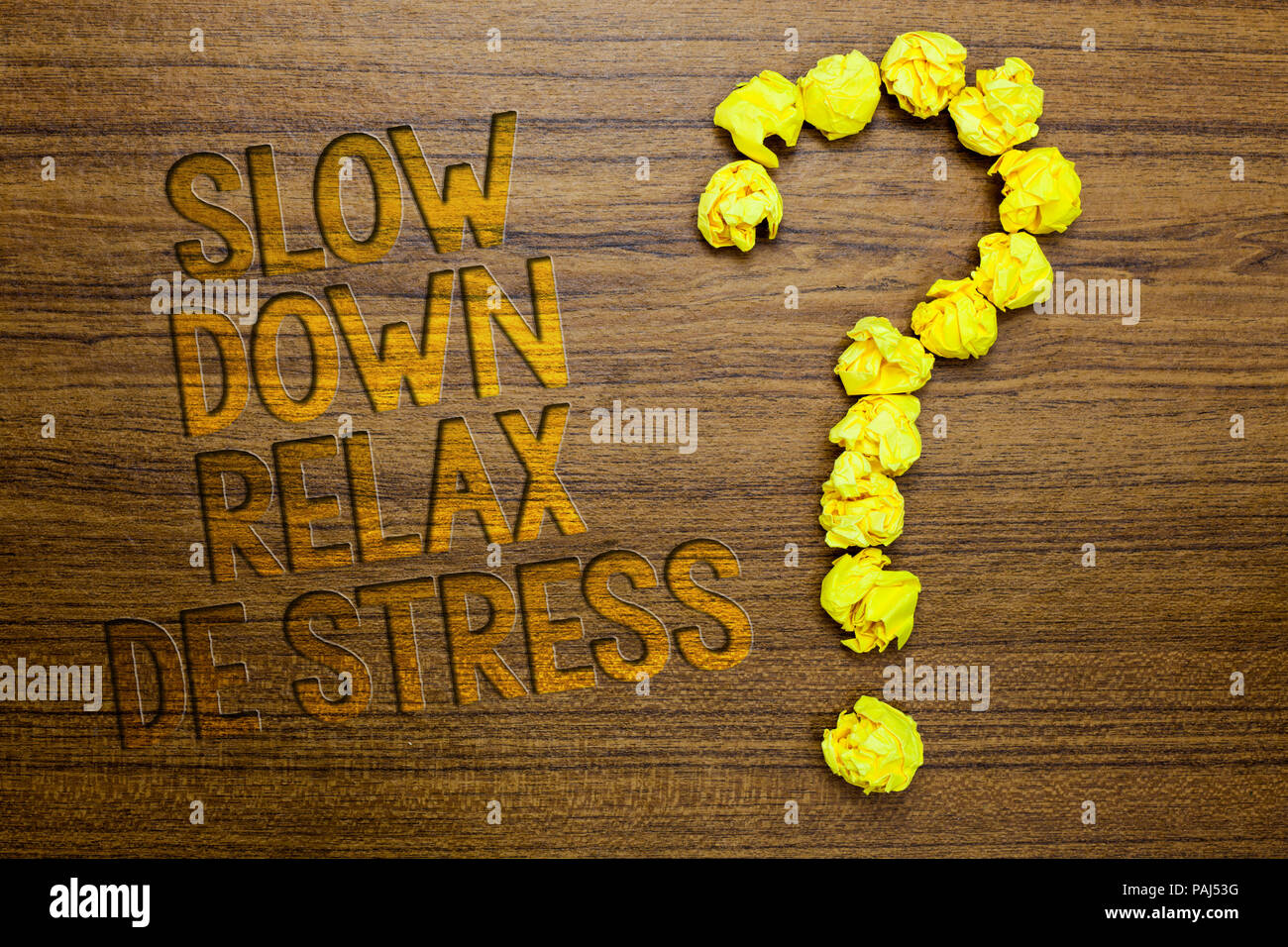 Word writing text Slow Down Relax De Stress. Business concept for Have a break reduce stress levels rest calm Wooden floor with some letters yellow pa - Stock Image