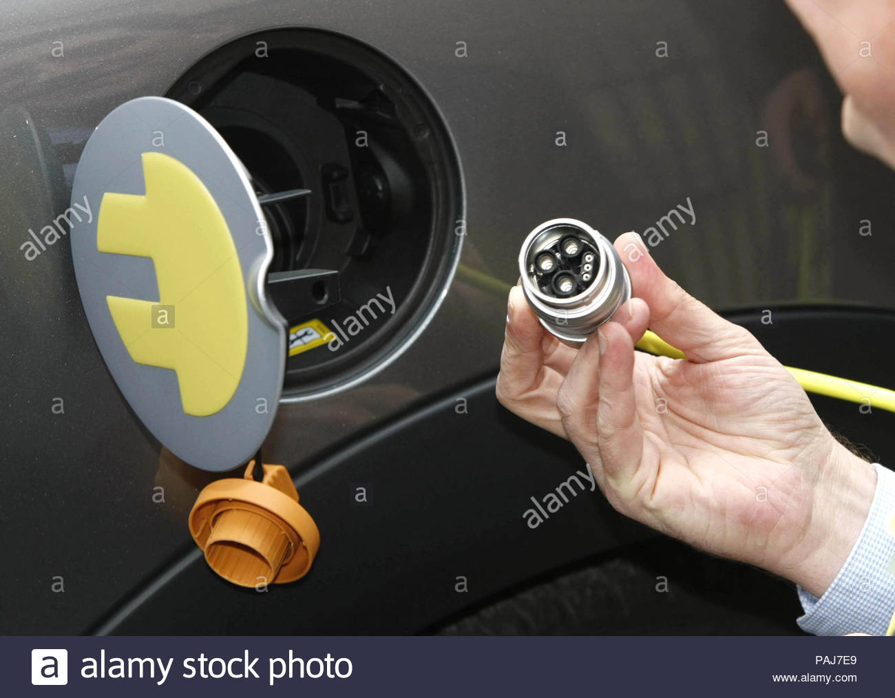 File photo dated 26/03/10 of an electric car being charged up, as the cost of charging electric vehicles could be reduced under proposals set out by the electricity market regulator. - Stock Image