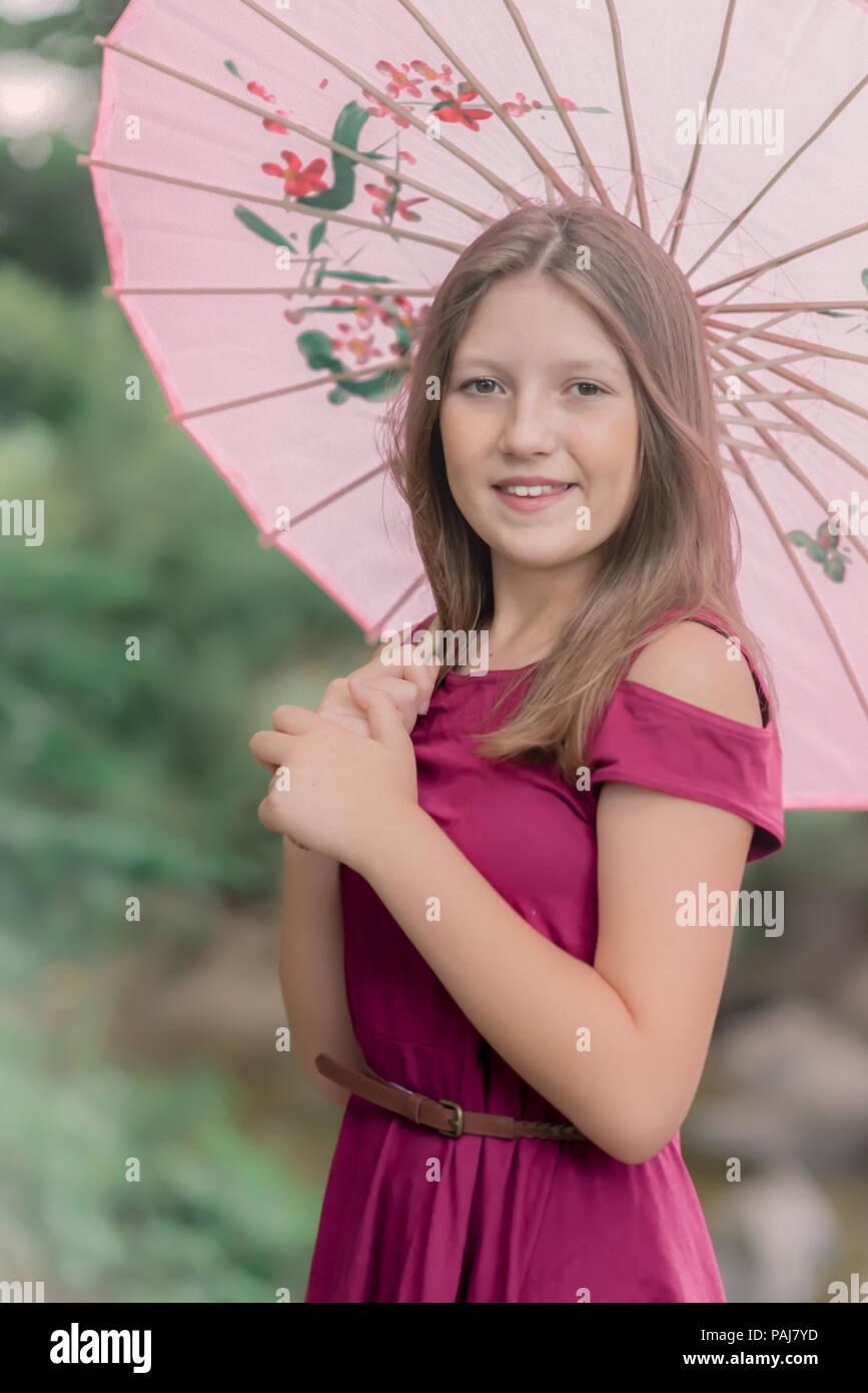 Pre teen girl outdoors - Stock Image