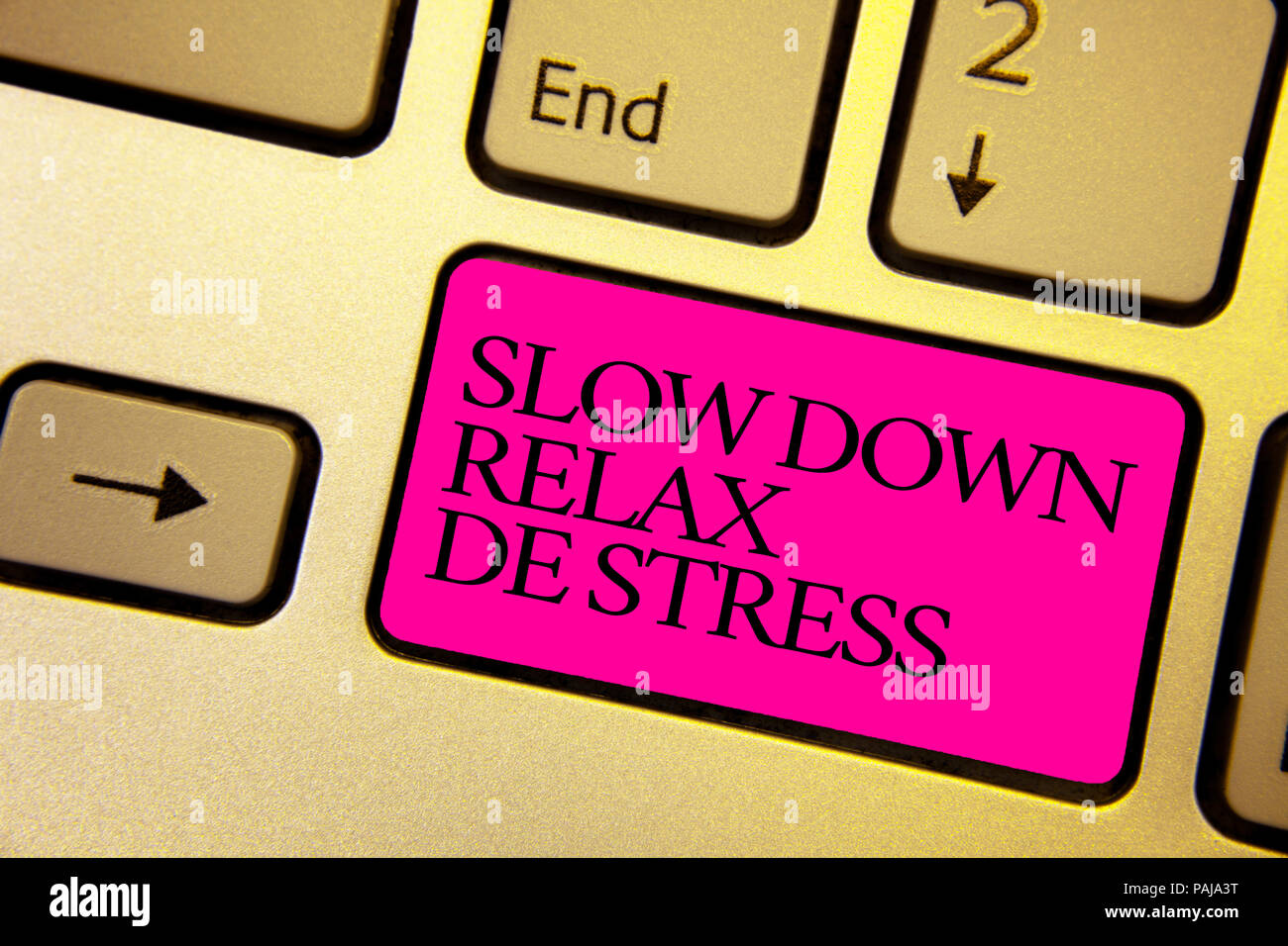 Word writing text Slow Down Relax De Stress. Business concept for Have a break reduce stress levels rest calm Bright golden computer keyboard with pin - Stock Image