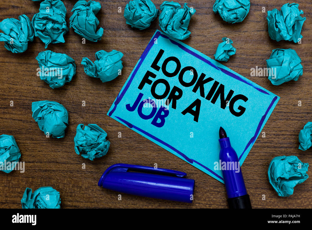 Conceptual hand writing showing Looking For A Job. Business photo showcasing Unemployed seeking work Recruitment Human Resources written blue letters  - Stock Image