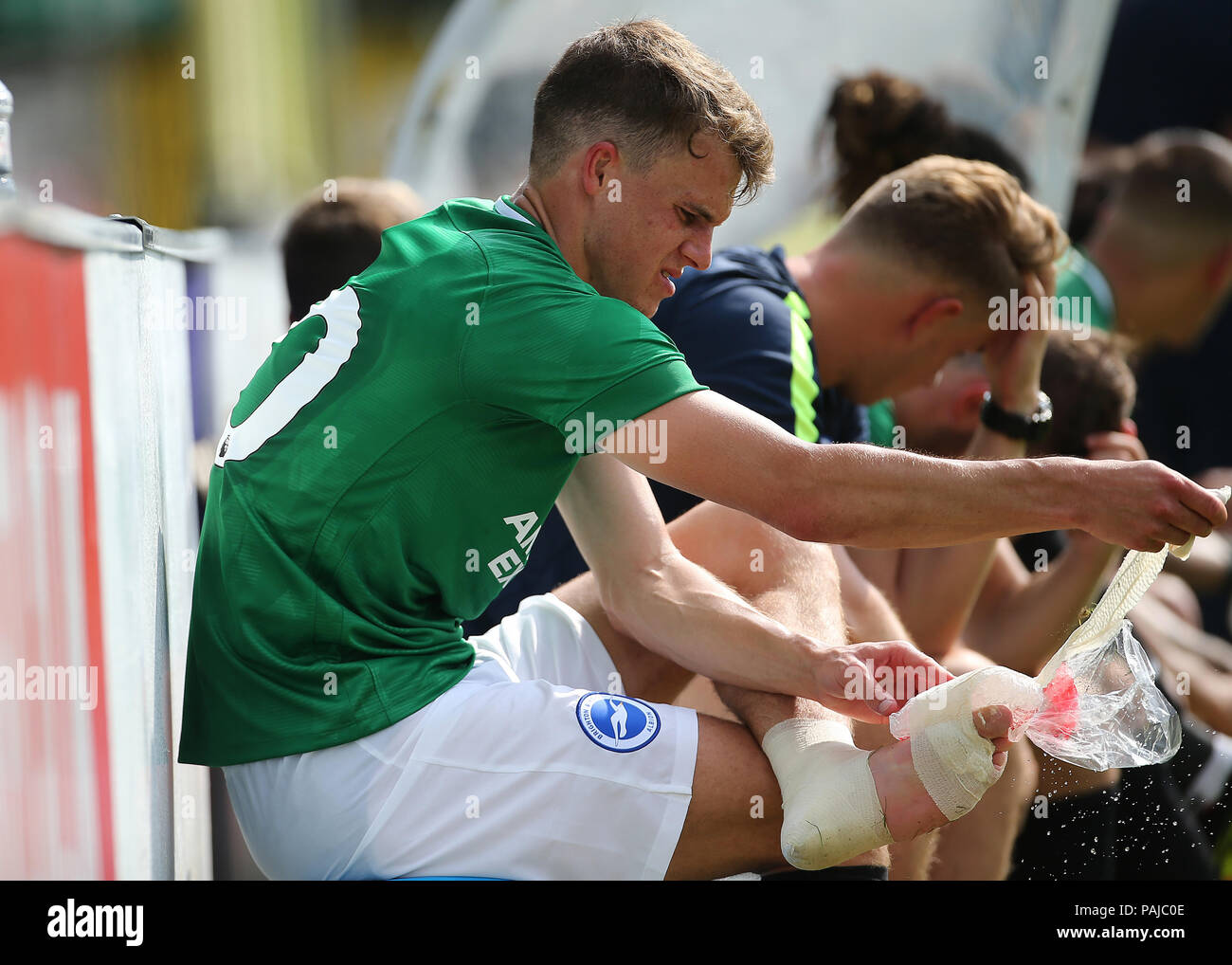 Brighton and Hove Albion'ss Solly March takes an ice pack of his left foot during a pre season friendly match at The Cherry Red Records Stadium, Kingston Upon Thames. PRESS ASSOCIATION Photo. Picture date: Saturday July 21, 2018. Photo credit should read: Mark Kerton/PA Wire. EDITORIAL USE ONLY No use with unauthorised audio, video, data, fixture lists, club/league logos or 'live' services. Online in-match use limited to 75 images, no video emulation. No use in betting, games or single club/league/player publications. - Stock Image