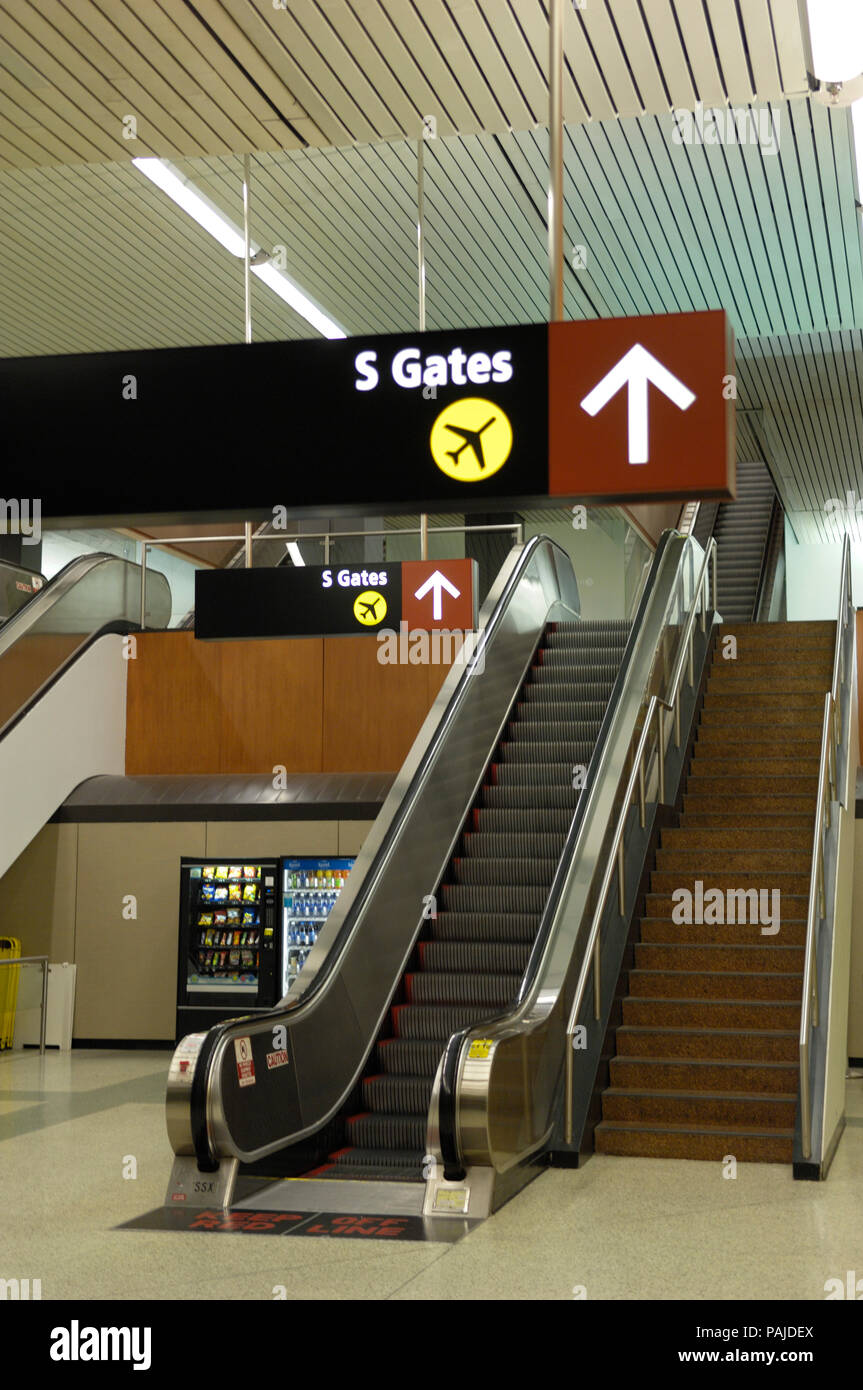 escalator, signs and arrow in the South Terminal Stock Photo