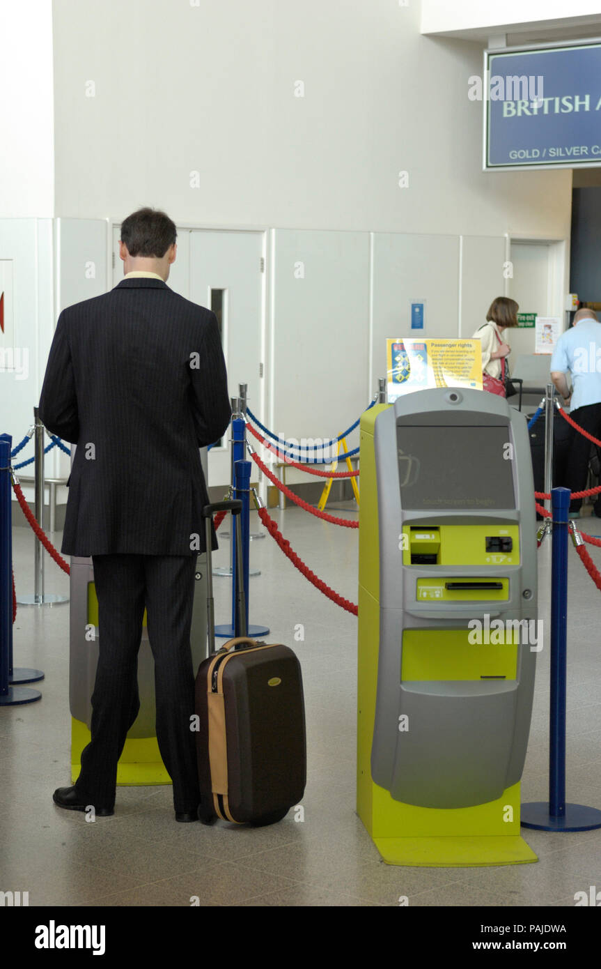passengers checking-in at British Airways self-service check-in kiosks managed by Aviance in Manchester Airport Terminal3, IBM series N kiosks Stock Photo